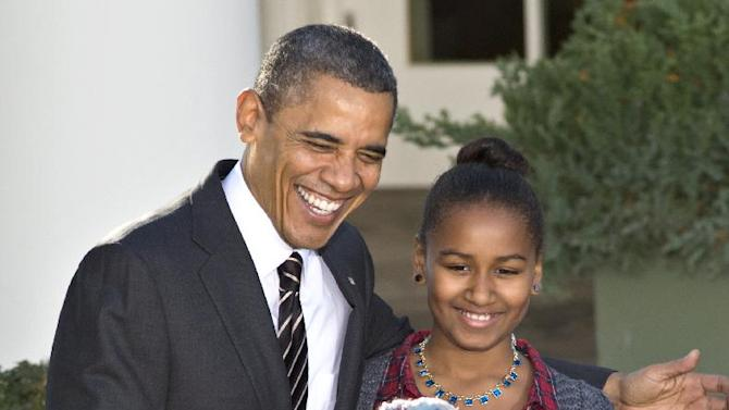"President Barack Obama, with daughter Sasha, carries on the Thanksgiving tradition of saving a turkey from the dinner table with a ""presidential pardon,"" Wednesday, Nov. 21, 2012, in the Rose Garden of the White House in Washington. After the ceremony, ""Cobbler"" will head to George Washington's historic home in Virginia to be part of the ""Christmas at Mount Vernon"" exhibition.  (AP Photo/J. Scott Applewhite)"