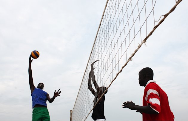 South Sudanese men play volleyball during a training session in the capital Juba