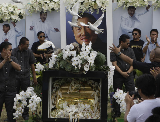 "Doves fly over the tomb of the country's ""King of Comedy"", Rodolfo Vera Quizon Sr., locally known as ""Dolphy"", during funeral rites at a cemetery in Taguig, south of Manila, Philippines on Sunday July"
