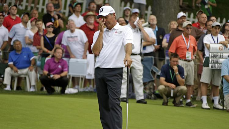 Fred Couples reacts after watching an eagle putt go long during the final round of the Senior Players Championship golf tournament at Fox Chapel Golf Club in Pittsburgh, Sunday, June 30, 2013. Couples parred the hole to finish tied for second with Duffy Waldorf at 17-under par, two strokes behind winner Kenny Perry at 19-under. (AP Photo/Gene J. Puskar)
