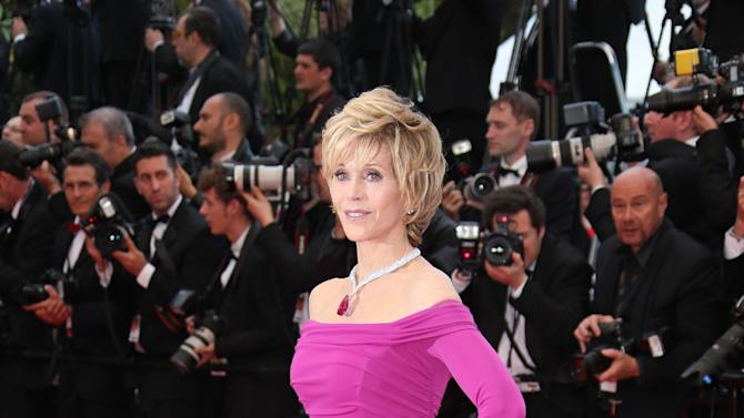 FILE - This May 19, 2013 file photo shows actress Jane Fonda wearing a purple-hued Badgley Mischka off-the-shoulder gown as she arrives for the screening of the film Inside Llewyn Davis at the 66th international film festival, in Cannes, southern France. (Photo by Joel Ryan/Invision/AP, file)