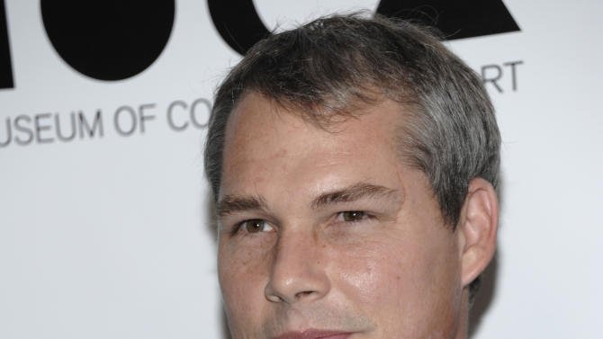 """FILE - In this Nov. 12, 2011 file photo, artist Shepard Fairey arrives at the MOCA Annual Gala in Los Angeles. Fairey, the man behind the Barack Obama """"HOPE"""" poster, on Friday, Sept. 7, 2012 will learn his sentence for criminal contempt after pleading guilty this year to destroying documents and fabricating others in a lawsuit pertaining to the Associated Press photograph he relied upon to make the poster. He faces up to six months in prison.  (AP Photo/Dan Steinberg, File)"""