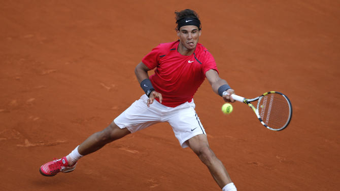 Rafael Nadal of Spain returns in his third round match against Eduardo Schwank of Argentina at the French Open tennis tournament in Roland Garros stadium in Paris, Saturday June 2, 2012. (AP Photo/Christophe Ena)
