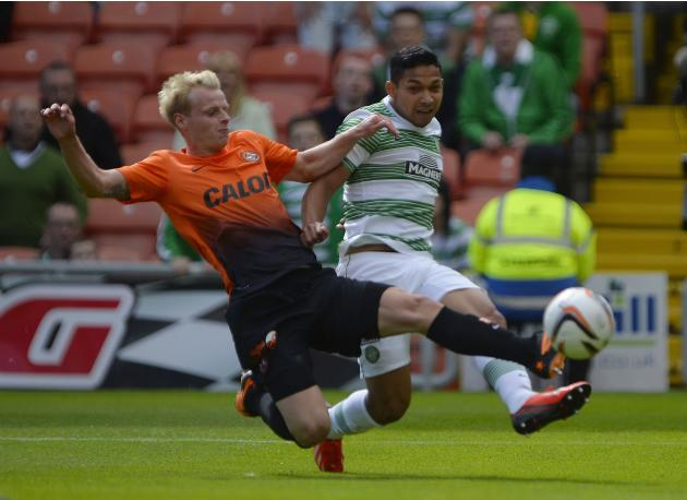 Dundee United's MacKay-Steven challenges Celtic's Izaguirre during their Scottish Premier League soccer match in Dundee