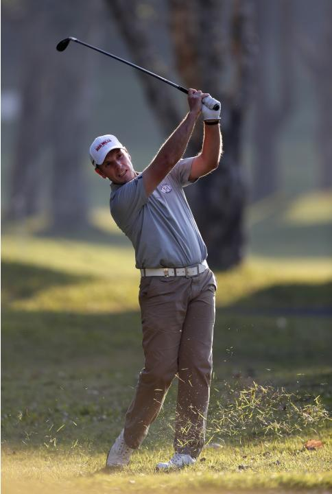 David Higgins of Ireland hits shot on ninth fairway during first day of Hong Kong Open golf tournament