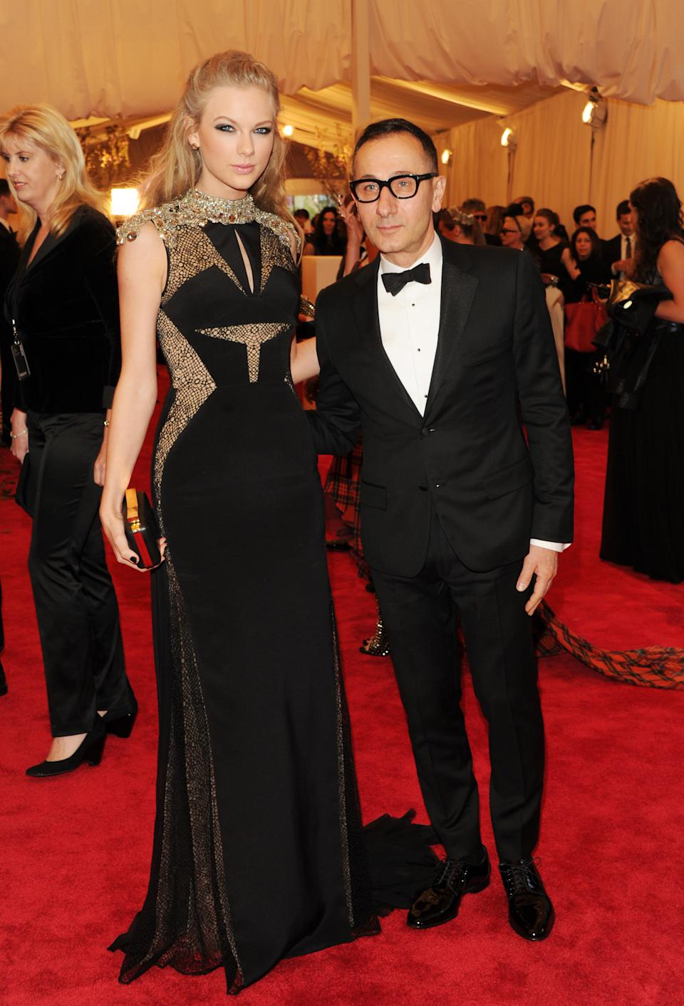"Taylor Swift and designer Gilles Mendel attend The Metropolitan Museum of Art's Costume Institute benefit celebrating ""PUNK: Chaos to Couture"" on Monday, May 6, 2013 in New York. (Photo by Evan Agostini/Invision/AP)"