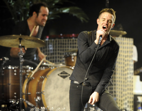"FILE - In this April 18, 2009 file photo, Brandon Flowers of The Killers performs during the band's headlining set on the second day of the Coachella Valley Music & Arts Festival in Indio, Calif. The Killers frontman wanted to get his voice right before hitting the studio to record the band's latest album, ""Battle Born,"" so he decided to take voice lessons. (AP Photo/Chris Pizzello, file)"