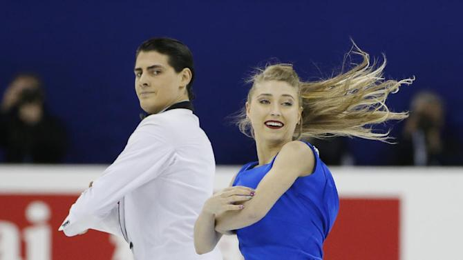 Piper Gilles and Paul Poirier of Canada perform during the Ice Dance Free Dance event in the ISU World Figure Skating Championship 2015 held at the Oriental Sports Center in Shanghai, China, Friday, March 27, 2015. (AP Photo/Ng Han Guan)