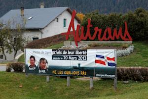 A banner in support of Pascal Fauret (L) and Bruno …