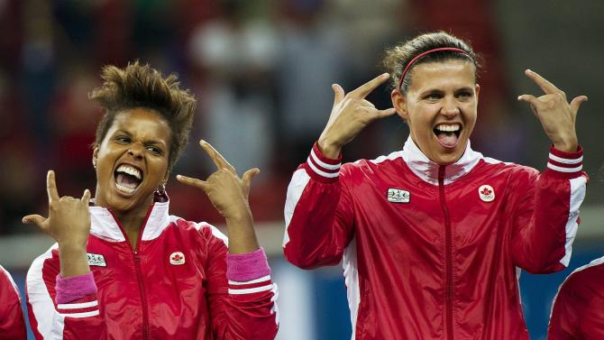 Canada goalie Karina LeBlanc, left, and teammate Christine Sinclair, right, react after Canada defeated Brazil in the women's soccer gold medal game at the Pan American Games in Guadalajara, Mexico, on Thursday, Oct. 27, 2011. (AP Photo/The Canadian Press, Nathan Denette)