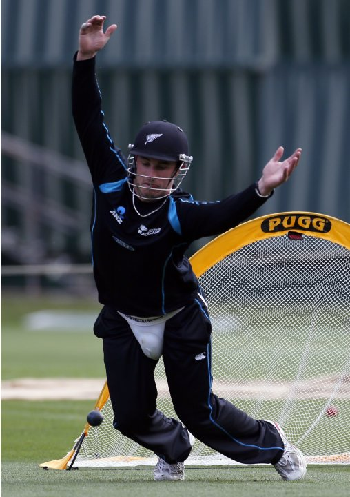 New Zealand cricket team player Hamish Rutherford reacts as he tries to catch a ball during a training session at the University Oval in Dunedin