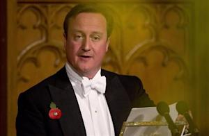 Britain's Prime Minister David Cameron delivers a speech at the Lord Mayor's Banquet at the Guildhall in the City of London