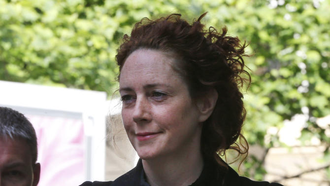 Former News International chief executive Rebekah Brooks arrives at a court in London, Wednesday May 5, 2013, to enter a plea to charges related to phone hacking. (AP Photo/Lefteris Pitarakis)