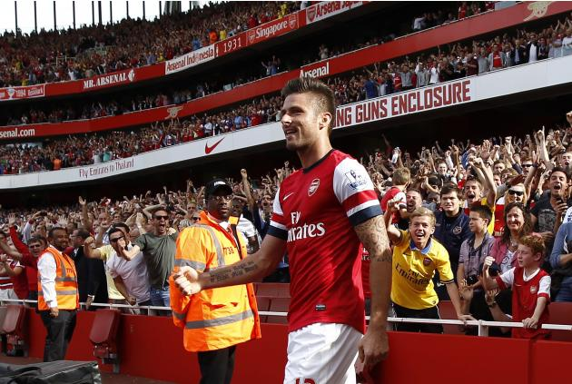 Arsenal's Giroud celebrates scoring against Tottenham Hotspur during their English Premier League soccer match at the Emirates Stadium in London