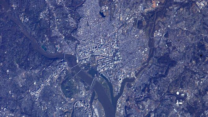 In this image provided by NASA the astronauts on board the International Space Station captured this view of Washington, D.C. and the surrounding area on Sunday, Jan. 20, 2013 one day before the public Inauguration of President Barack Obama. This detailed view shows the Potomac River and its bridges at left, with National Mall at the center, stretching eastward from the Lincoln Memorial to the Washington Monument toward the Capitol building, where the inaugural ceremony will be held. (AP Photo/NASA)