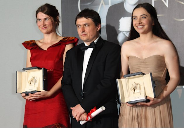 Director Cristian Mungiu, center, and actresses Cristina Flutur, left, and Cosmina Stratan pose with their awards during a photo call for the Best Director and Best Actress award for Beyond the Hills 