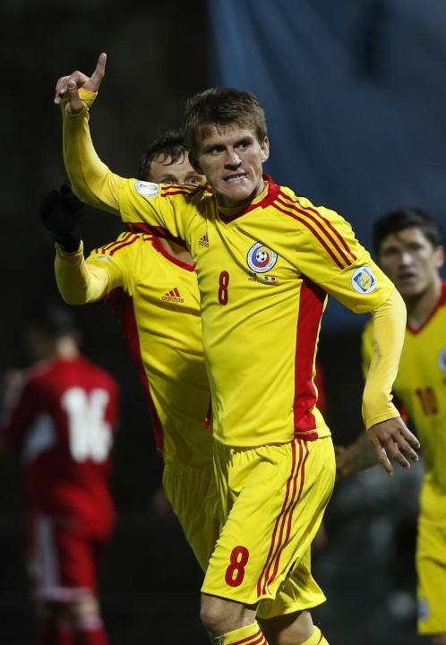 Romania's Costin Lazar celebrates a goal against Andorra during their 2014 World Cup qualifying soccer match at Estadi Comunal in Andorra