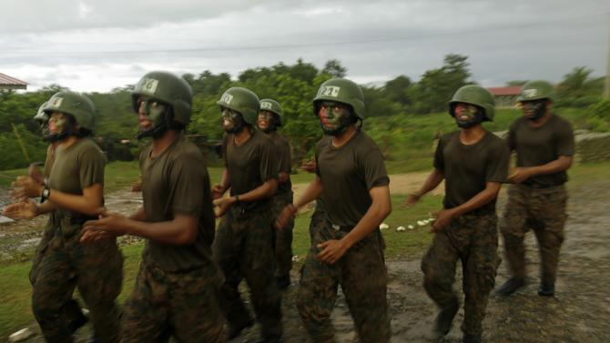Members of Panama's border police train during a media tour to different strategic police base points as part of a strategy to combat the war on drugs in the Darien province