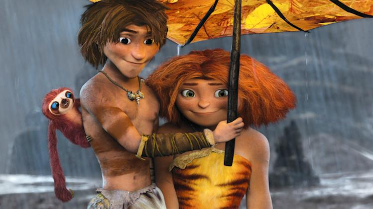 "This film publicity image released by DreamWorks Animation shows, from left, Belt the sloth, voiced by Chris Sanders, Guy, voiced by Ryan Reynolds, and Eep, voiced by Emma Stone, in a scene from ""The Croods."" (AP Photo/DreamWorks Animation)"