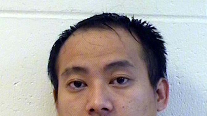This photo provided by the Marathon County, Wis., Sheriff's Department shows Kou Thao, 26, of Wausau, Wis., who was charged Monday, April 22, 2013, with first-degree intentional homicide in the slaying and dismemberment of a Minnesota man. A criminal complaint says Thao fatally shot Tong Pao Hang, of St. Paul, in the basement of a Wausau home, wrapped his body in a tarp, loaded it in a car and drove to Milwaukee April 17. Hang's severed head was found in the trunk of a car and other body parts were found in the basement of a Milwaukee home, according to the complaint. (AP Photo/Marathon County Sheriff)