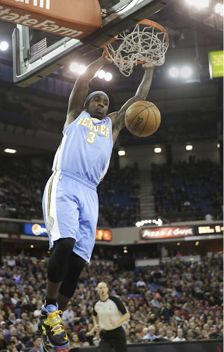 Denver Nuggets guard Ty Lawson hangs on the rim on a break away stuff against the  Sacramento Kings during the first quarter of an NBA basketball game in Sacramento, Calif., Sunday, Jan. 26, 2014