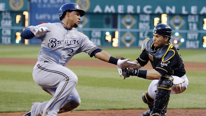 Pittsburgh Pirates catcher Russell Martin, right, prepares to tag Milwaukee Brewers' Carlos Gomez at home plate as Gomez tried score from third on a ground ball by Jonathan Lucroy in the fourth inning of a baseball game Saturday, June 29, 2013, in Pittsburgh. Lucroy was safe at first. (AP Photo/Keith Srakocic)