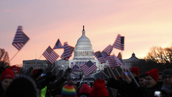 President Barack Obama supporters wave American flags on the National Mall in Washington, Monday, Jan. 21,  2013, prior to the start of President Barack Obama's ceremonial swearing-in ceremony during the 57th Presidential Inauguration. ( AP Photo/Jose Luis Magana)