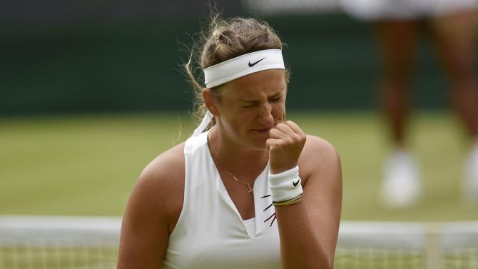 Victoria Azarenka of Belarus reacts during her match against Serena Williams of the U.S.A. at the Wimbledon Tennis Championships in London