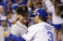 Kansas City Royals manager Ned Yost shakes hands with San Francisco Giants manager Bruce Bochy before Game 1 of baseball's World Series Tuesday, Oct. 21, 2014, in Kansas City, Mo. (AP Photo/David J. Phillip)