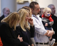 Gayle Inge, second from left, mother of country singer Mindy McCready, attends a memorial service for McCready with family and friends on Wednesday, March 6, 2013, in Nashville, Tenn. McCready committed suicide Feb. 17 in Heber Springs, Ark. (AP Photo/Mark Humphrey)