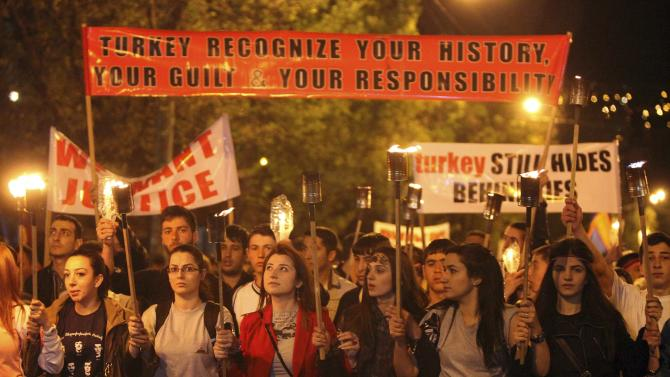 Demonstrators attend a torch-bearing march marking the anniversary of the 1915 mass killings of Armenians in the Ottoman Empire, in Yerevan
