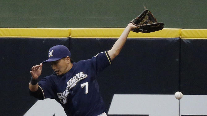 Milwaukee Brewers right fielder Norichika Aoki can't catch a triple hit by Los Angeles Dodgers' Andre Ethier during the second inning of a baseball game Monday, May 20, 2013, in Milwaukee. (AP Photo/Morry Gash)
