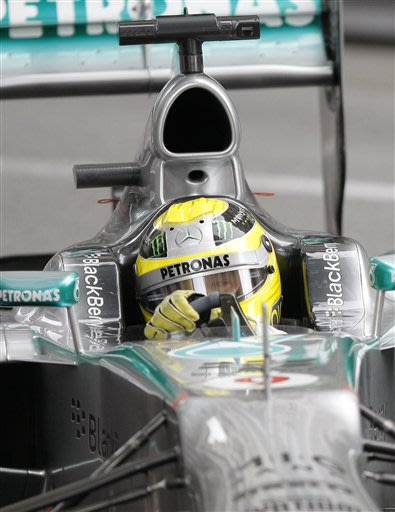 Mercedes driver Nico Rosberg of Germany steers his car during the qualifying session, at the Monaco racetrack in Monaco, Saturday, May 25, 2013.  He clocked the fastest time. The Formula one race will