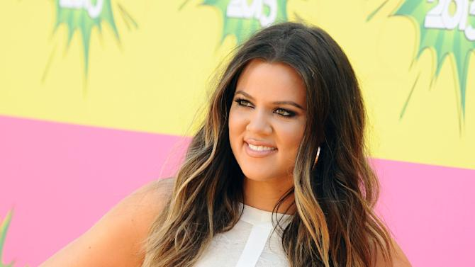 """FILE - In this March 23, 2013 file photo, Khloe Kardashian arrives at the 26th annual Nickelodeon's Kids' Choice Awards, in Los Angeles. New York Gov. Andrew Cuomo sent a letter to Khloe Kardashian's informing the reality star that the logo on her T-shirt line may be violating copyright law. Her T-shirt line resembles the logo of a New York farm program. The state's design has an image of the Statue of Liberty above crop rows, encircled by the words """"Pride of New York.""""  (Photo by Jordan Strauss/Invision/AP, File)"""
