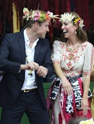 Prince William (L) and his wife Catherine dance during a &#39;fatale&#39;, a singing and dancing event in Tuvalu on September 18. A Danish magazine on Thursday became the latest to run pictures of Catherine topless, despite moves by furious British royals to stop the spread of the photos