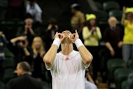 Britain&#39;s Andy Murray celebrates winning his third round men&#39;s singles match against Cyprus&#39;s Marcos Baghdatis on day six of the 2012 Wimbledon Championships tennis tournament at the All England Tennis Club in Wimbledon, southwest London. Murray clinched a 7-5, 3-6, 7-5, 6-1 win over Baghdatis in a match which finished just past the 11pm Centre Court curfew