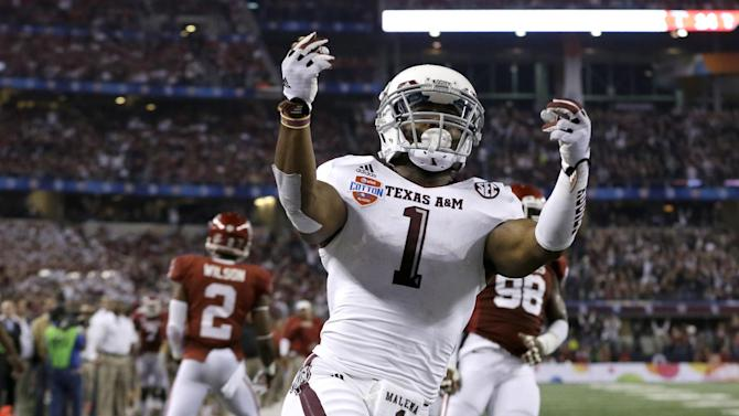 Texas A&M's Ben Malena (1) celebrates his touchdown as Oklahoma's Julian Wilson (2) and Chuka Ndulue (98) walk away in the second half of the Cotton Bowl NCAA college football game Friday, Jan. 4, 2013, in Arlington, Texas. (AP Photo/LM Otero)