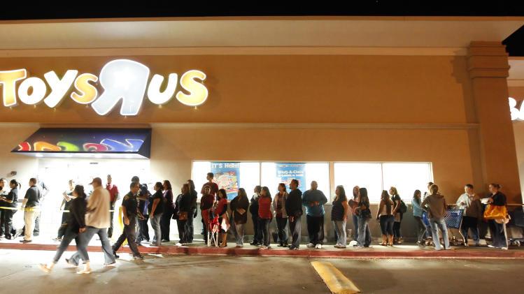 The line stretched throughout the shopping center as people lined up at Toys R Us in Corpus Christi, Texas,  on Thursday, Nov. 24, 2011, for the 9 p.m. opening of the store. Black Friday sales began in earnest as stores opened their doors at midnight. (AP Photo/Corpus Christi Caller-Times, Rachel Denny Clow)