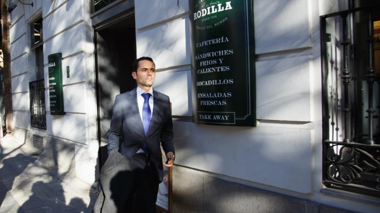 Judicial clerk Fernandez Gallardo walks down the street after leaving ruling People's Party headquarters in Madrid