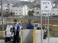 Israeli policemen stand guard near the scene of what the Israeli army said was a suspected Palestinian stabbing attack, south of Hebron