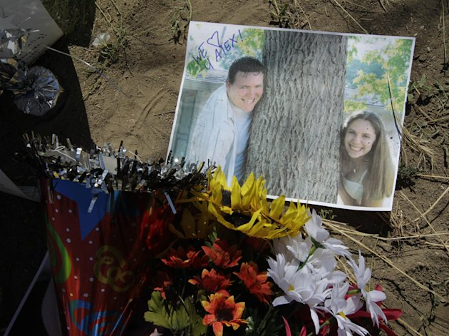 A photograph of theater shooting victim Alex Sullivan and his wife Cassie are shown, Saturday, July 21, 2012, at a memorial near the movie theater in Aurora, Colo.  Twelve people were killed and dozen