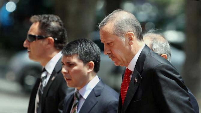 """Turkish Prime Minister Recep Tayyip Erdogan, right, arrives for a cabinet meeting in his office in Ankara, Turkey, Monday, June 25, 2012. Upon Turkey's request, NATO will hold a meeting Tuesday in Brussels over article 4 of its charter concerning Friday's incident, when a Turkish warplane was shot down by Syria. Syria's Foreign Ministry spokesman Jihad Makdissi said Monday his country has """"no hostility"""" toward Turkey as tensions soar between the former allies three days after Syria shot down a Turkish plane. (AP Photo)"""
