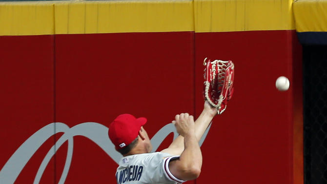 Philadelphia Phillies right fielder Jeff Francoeur cannot reach a ball hit two-run double by Atlanta Braves' Nick Markakis in the fourth inning of a baseball game Saturday, July 4, 2015, in Atlanta. (AP Photo/John Bazemore)