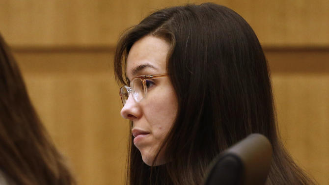 Defendant Jodi Arias listens to prosecutor Juan Martinez makes his closing arguments during her trial at Maricopa County Superior Court in Phoenix on Thursday, May 2, 2013. Arias is charged with first-degree murder in the stabbing and shooting death of Travis Alexander, 30, in his suburban Phoenix home in June 2008. (The Arizona Republic, Rob Schumacher, Pool)