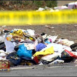Neighbor: Police Search Trash Load After Reports Of A Dumped Baby