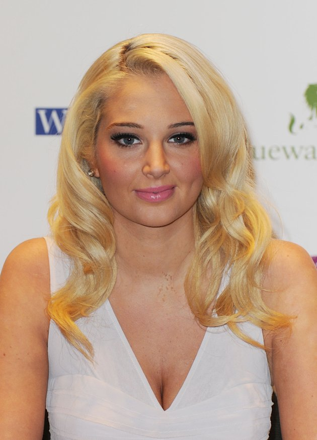 Tulisa does pretty pink lips at book signing in London