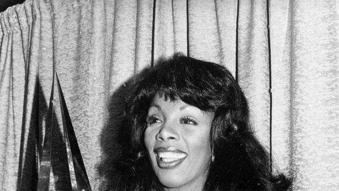 "FILE - In this Jan. 12, 1979 file photo, singer Donna Summer poses with three awards she won at the American Music Awards in Los Angeles, Calif. Summer, the Queen of Disco who ruled the dance floors with anthems like ""Last Dance,"" ""Love to Love You Baby"" and ""Bad Girl,"" has died. Her family announced her death in a statement Thursday, May 17, 2012.  She was 63. (AP Photo/Nick Ut, File)"