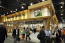 Attendees pass by the General Growth Properties booth during the International Council of Shopping Centers convention in Las Vegas