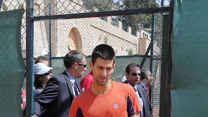 Novak Djokovic of Serbia arrives for a practice session at the Monte Carlo Tennis Masters tournament in Monaco, Tuesday, April 16, 2013. (AP Photo/Lionel Cironneau)