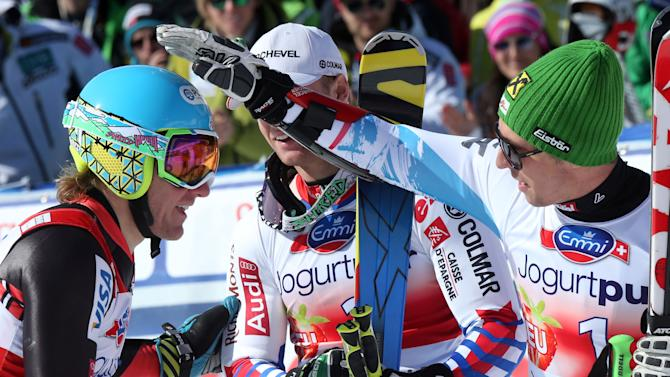 Ted Ligety of the United States is congratulated by Austria's Marcel Hirscher, right, after the men's alpine skiing giant slalom competition during  the World Cup finals in Lenzerheide, Switzerland, Saturday, March 16,  2013. (AP Photo/Armando Trovati)